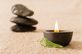 Fotografie Spa still life candle with zen stones