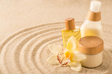 Photo Spa body product on sand orchid flower