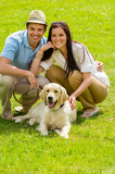 Fotografie Young happy couple with Labrador dog