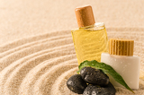 Fotografie Spa therapy cosmetic products with zen stones
