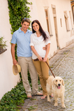 Fotografie Modern couple with dog in romantic city