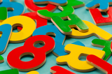 Fotografie Colored wooden numbers and letters for children