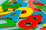 Colored wooden numbers and letters for children