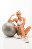 Photo Successful fitness woman with exercise ball white