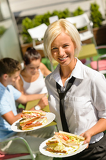 Waitress bringing sandwiches on plates fresh lunch