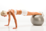 Photo Woman gym ball pushups at white fitness