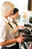 Waitresses at work make coffee machine cafe