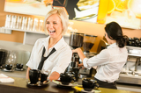 Fotografie Waitress serving coffee cups making espresso woman