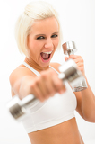 Fotografia Excited fitness woman workout dumbbells exercise