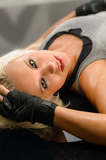 Fotografie Woman kickboxer in black relax on floor
