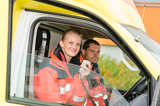 Fotografie Emergency paramedic in ambulance car talk radio