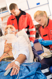 Fotografie Sick patient with paramedic in ambulance treatment