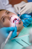Teeth check-up open mouth and dental tools