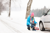 Photo Snow tire chains winter car woman trouble