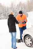 Fotografie Woman handshake mechanic broken car winter help