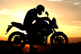 Fotografie motorcyclist silhouette at the sunset