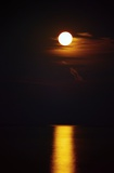 Full moon. Moon and its glow is reflected on the surface of the sea. Northern Greece.