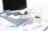 Man's tie laying on business office desk