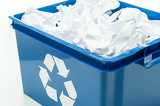 Blue recycling bin box with paper waste