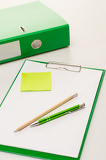 Eco business office accessories on green clipboard