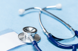 Blue stethoscope medical equipment close-up