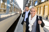 Fotografie Woman smiling in train station man phone