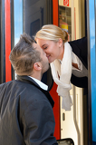 Fotografie Man kissing woman goodbye train leaving romance