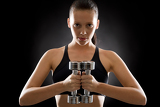 Fotografia Young woman exercise weights black background