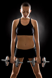 Photo Fitness woman exercise weights on black