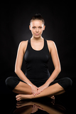 Young Caucasian woman doing yoga legs crossed