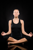 Young woman sitting in lotus position meditating