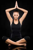 Fotografie Young woman performing yoga with raised hands