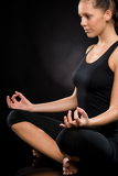 Fotografie Relaxed young woman exercising in lotus position