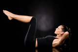 Photo Woman doing stretching exercise with raised legs