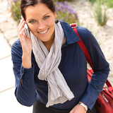 Fotografie Smiling woman talking phone calling elegance businesswoman