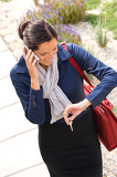 Woman calling rushing arriving home business phone