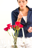 Photo Woman setting table romantic dinner roses Valentine's