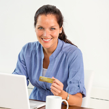Photo Smiling woman paying bills online banking home