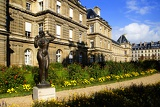 Historical building, palace, bronze statue of a woman and a park. Paris - France.
