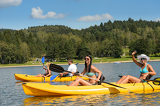 Young people sunbathing on kayak