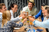 Fotografia Group of cheerful people toasting with drinks