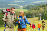Fotografie Young hiking friends reading map find track