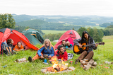 Fényképek Camping students listening girl with guitar tents
