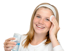 Fotografia Young cheerful girl removing make-up cleansing pad