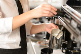 Fotografie Barista steaming milk for hot cappuccino