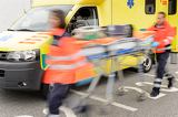 Fotografie Running blurry paramedics team with stretcher