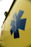 Fotografie Blue star paramedics logo yellow ambulance car