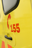 Fotografie Rescue team's telephone number yellow ambulance car