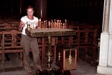 Fotografie Summer. Rhodes Town. Female, candles and the Orthodox church. Rhodes Island - Greece.