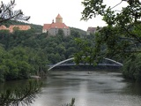 Photo Panoramic view of the castle on the photo below river over which the bridge tourist bars.